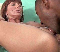 Milfs Desi Foxx and Dorothy unload a hard cock in the first place their face