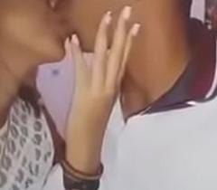 Indian boy kissing his girlfriend