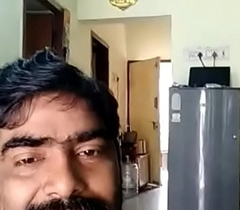 Indian uncle resembling detect give his wife